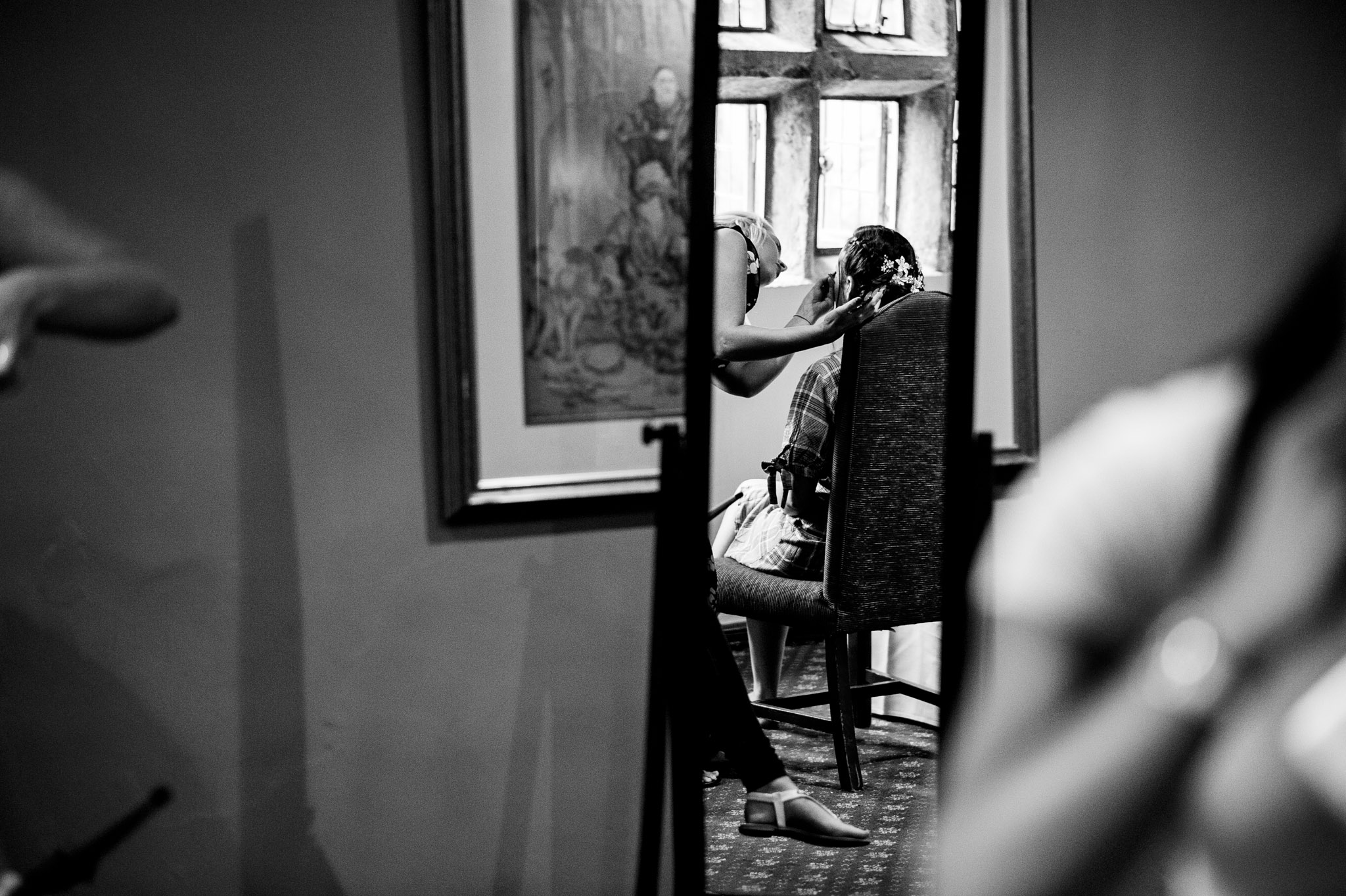 The bride has her makeup done at Holdworth House - photo from a mirror