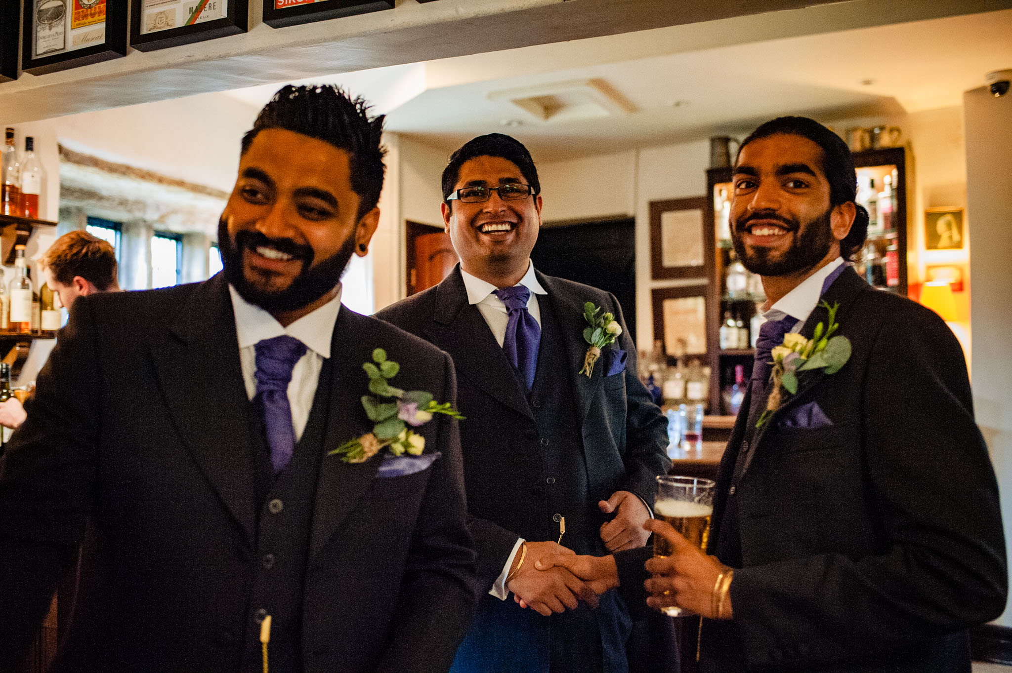 The groom shakes hands with his brothers