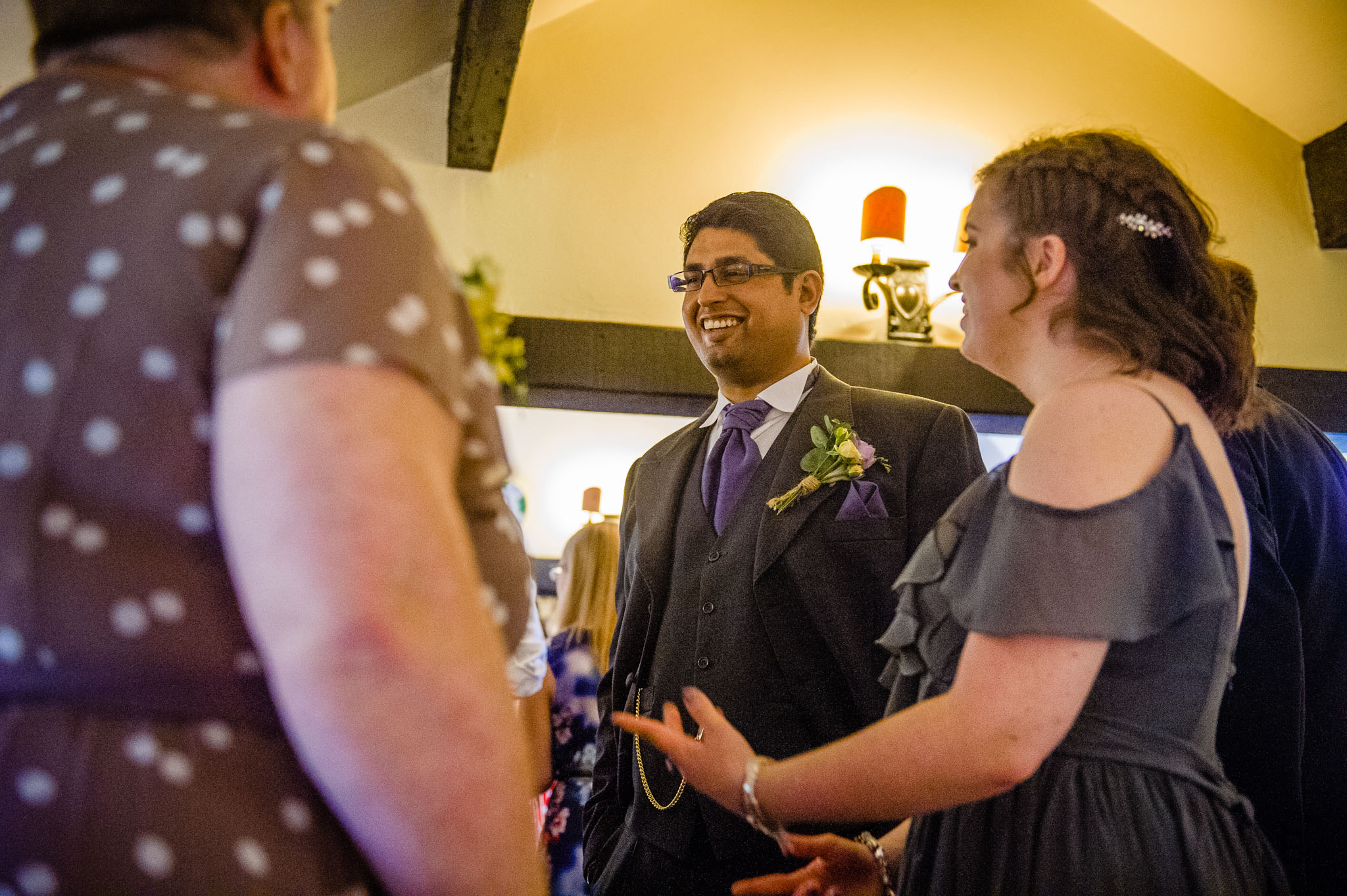 The groom chats with guests before the wedding begins