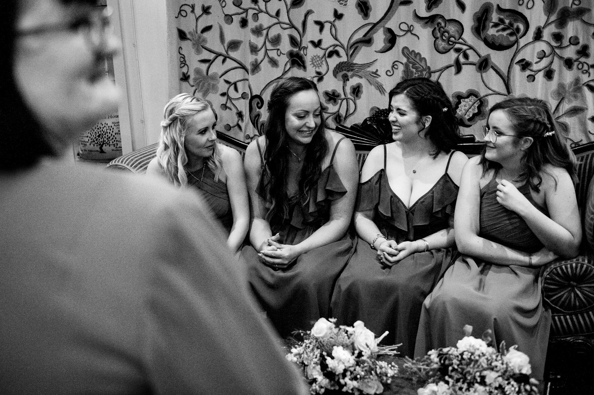 The bridesmaids have a laugh and a giggle before the ceremony begins