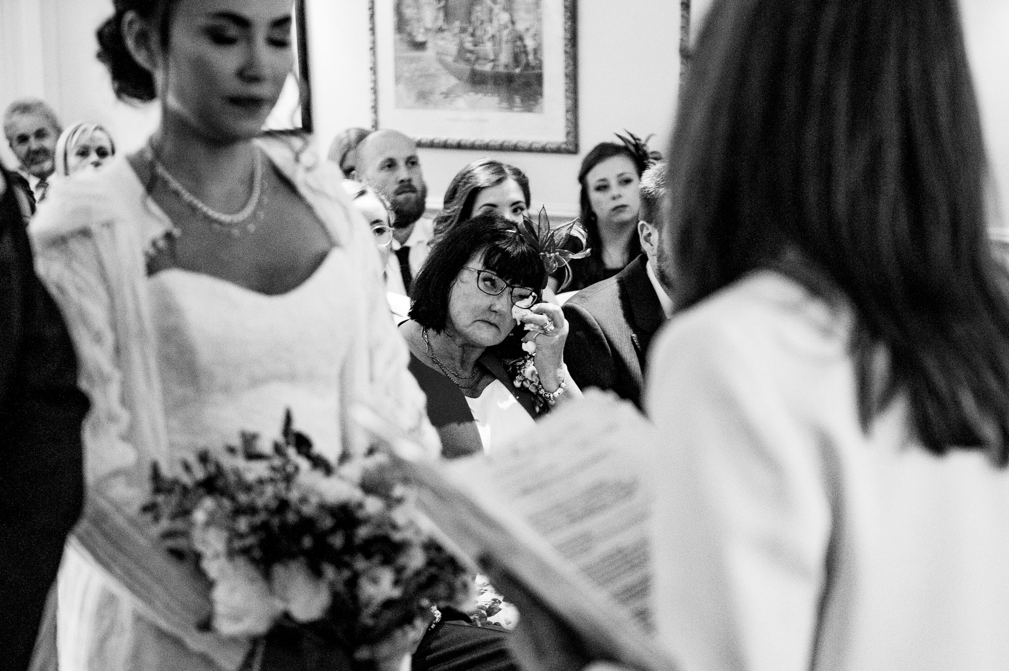 Mother of the bride wipes away a tear