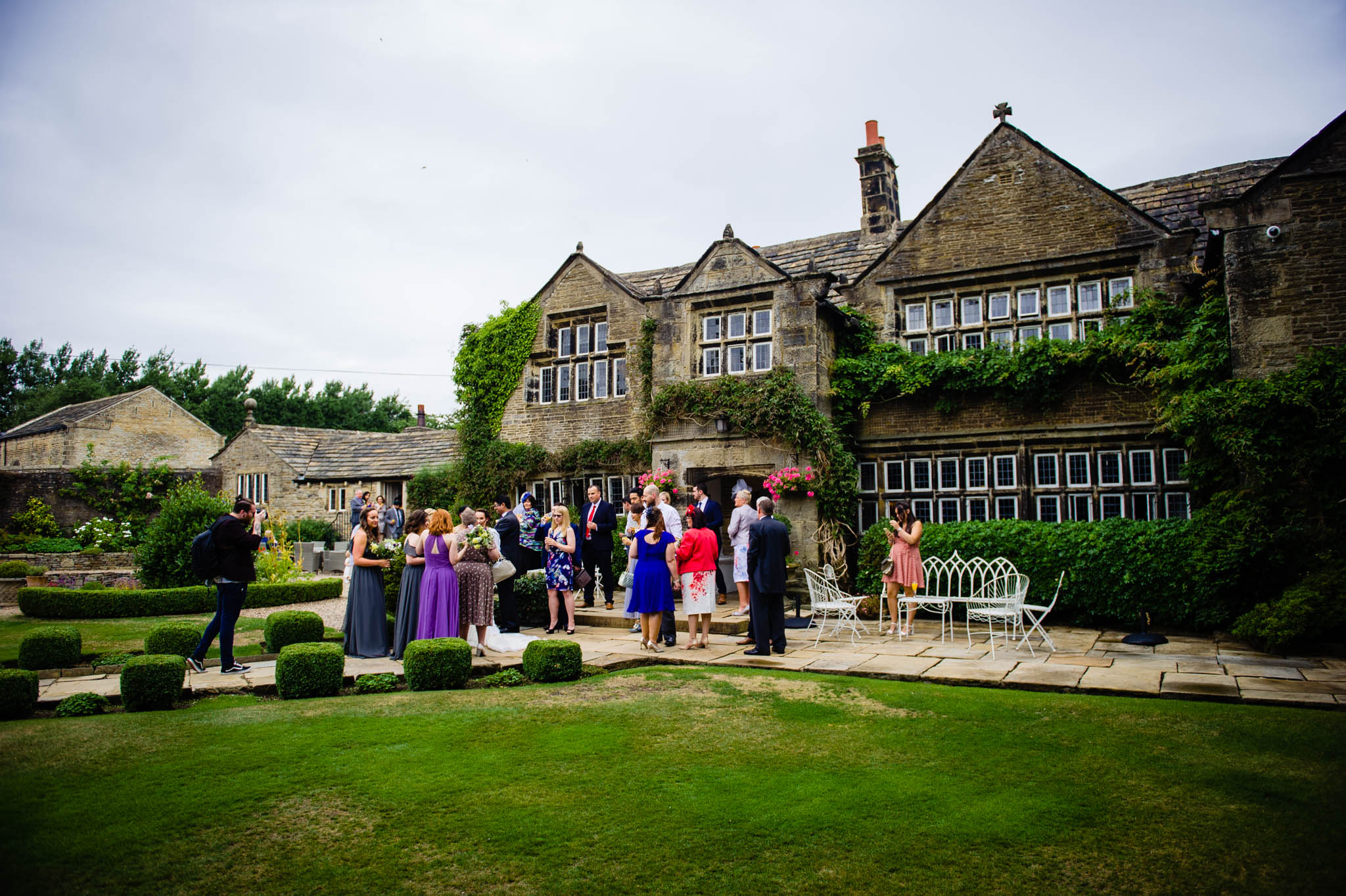 Guests gather for a chat in the grounds of Holdsworth House