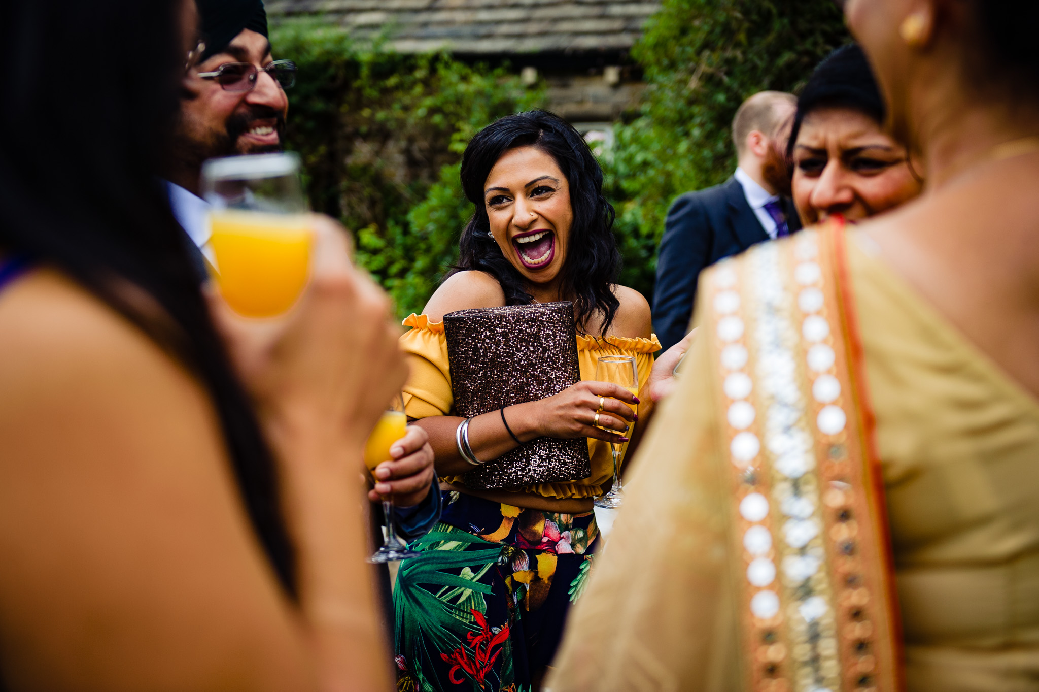 Epic laugh from this wedding guest!