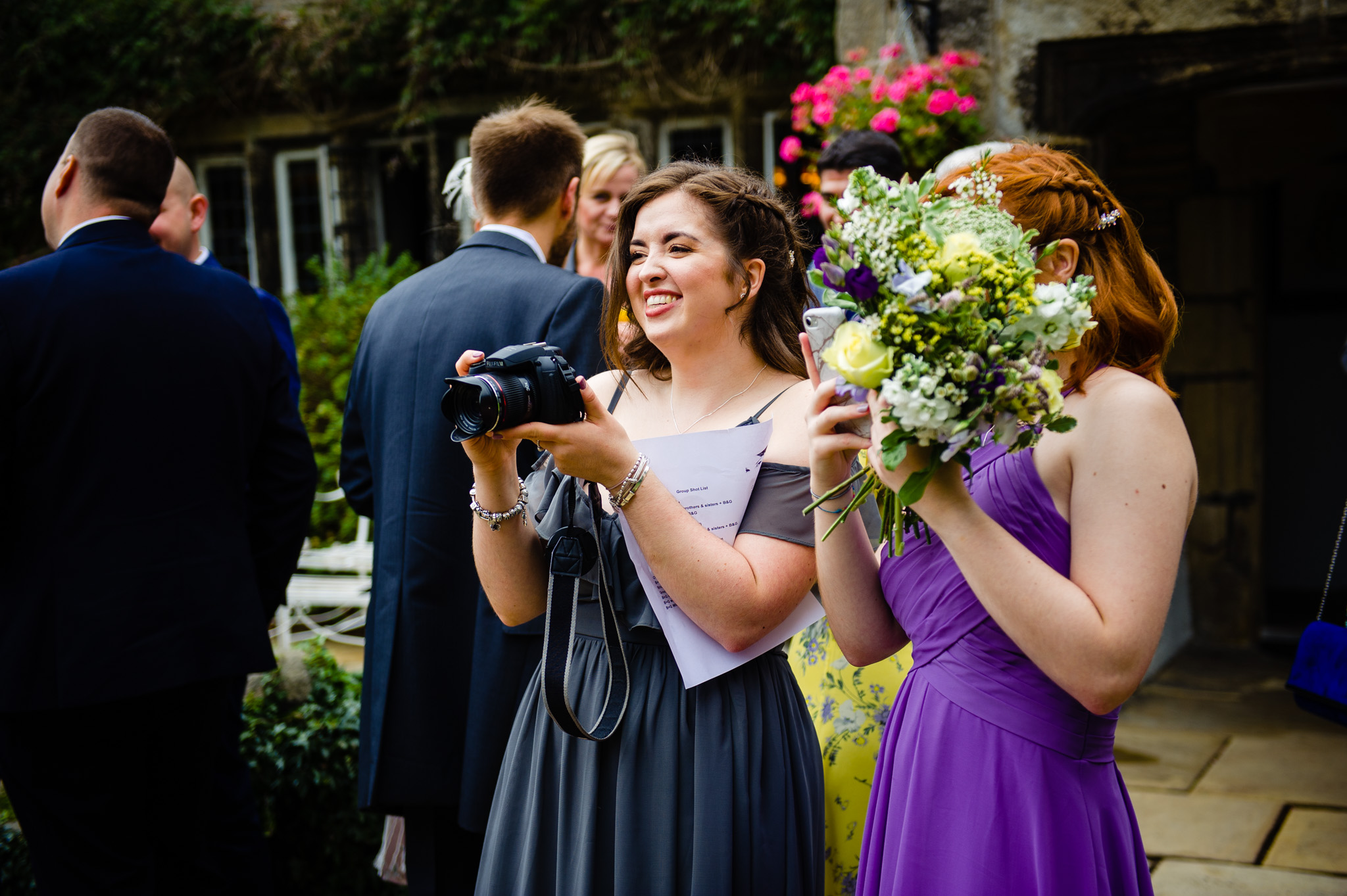 Bridesmaid practices her skills with a camera