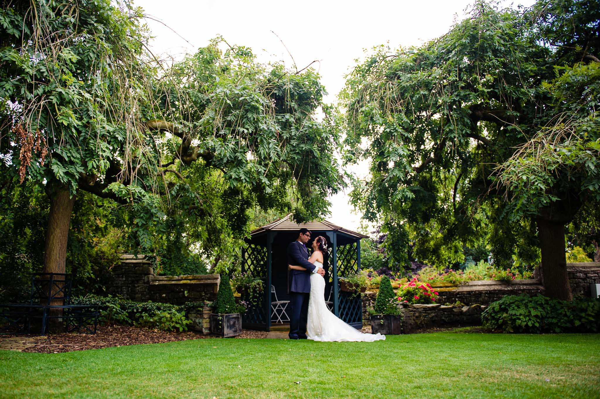 The married couple have a hug by the the Gazeebo