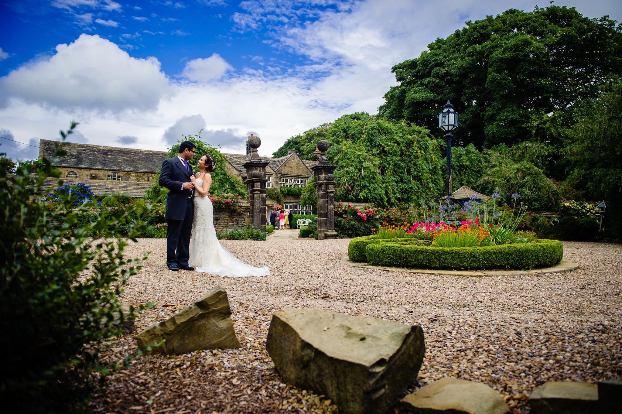 Birde and groom relax in the grounds of Holdsworth Houe