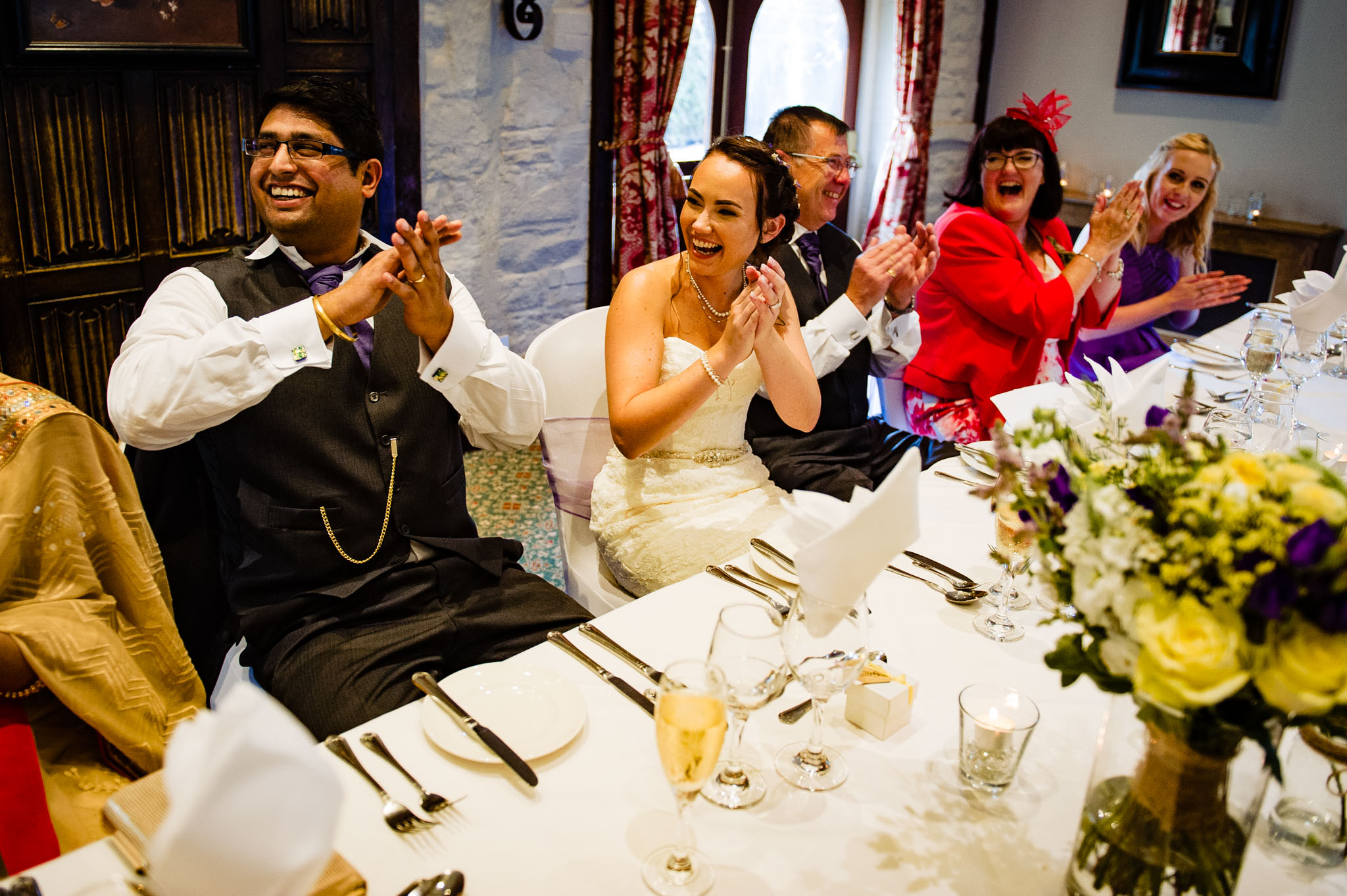 The head table claps during the wedding speeches