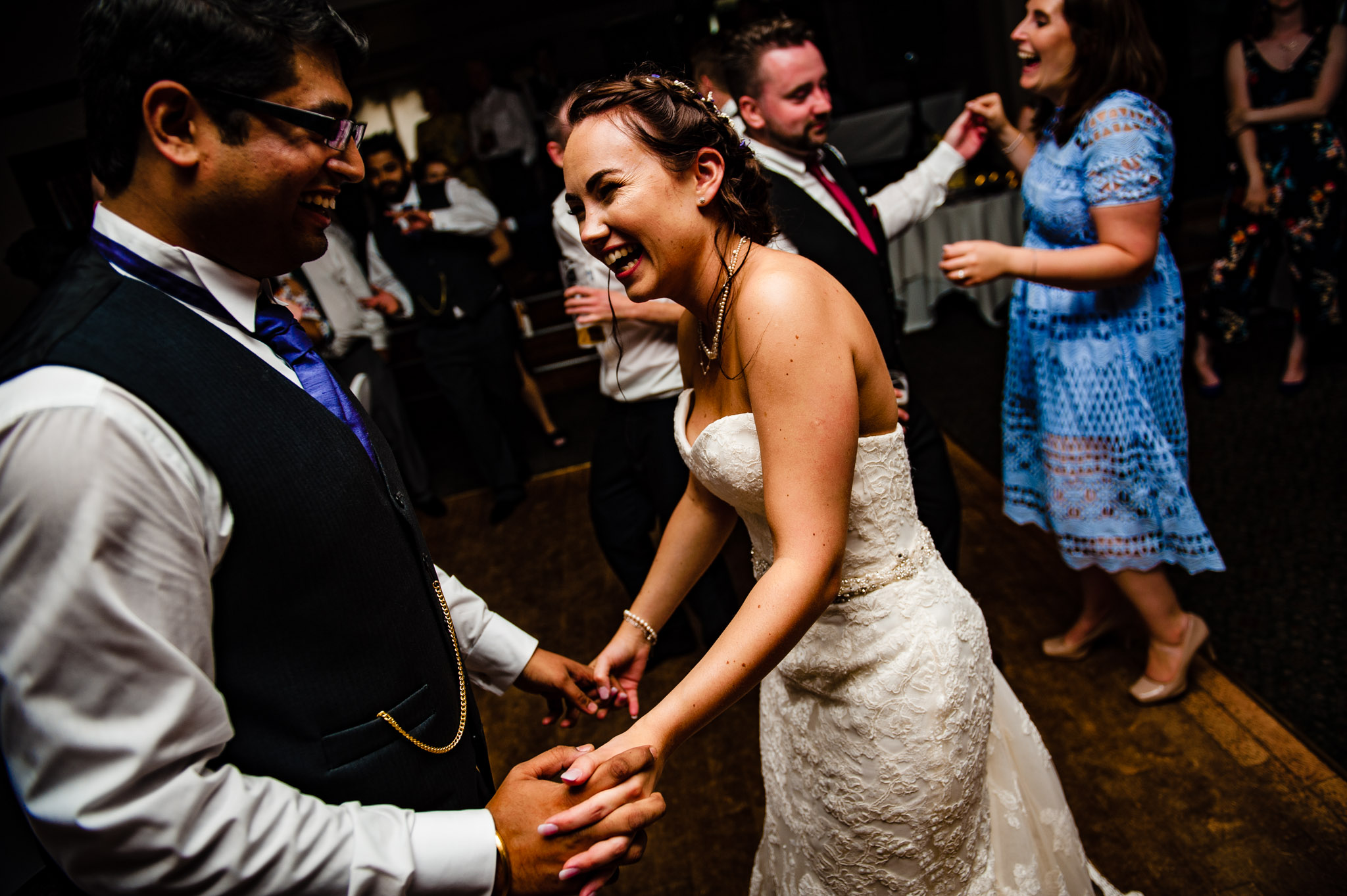 Bride and groom laughing while dancing