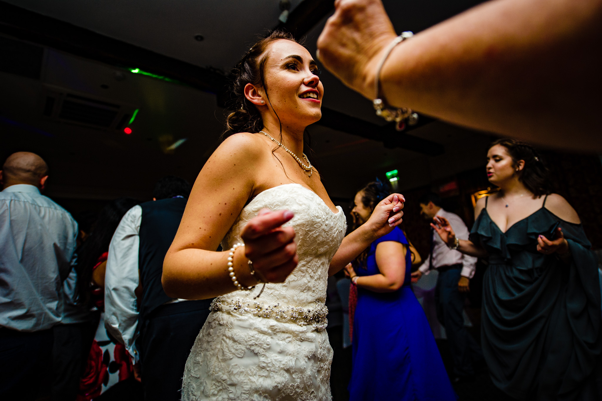 The bride enjoys the music at Holdsworth House