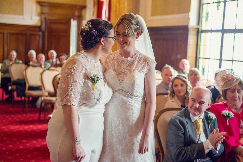 Bride and Bride enjoy a moment during the ceremony - Bury Wedding Photographer