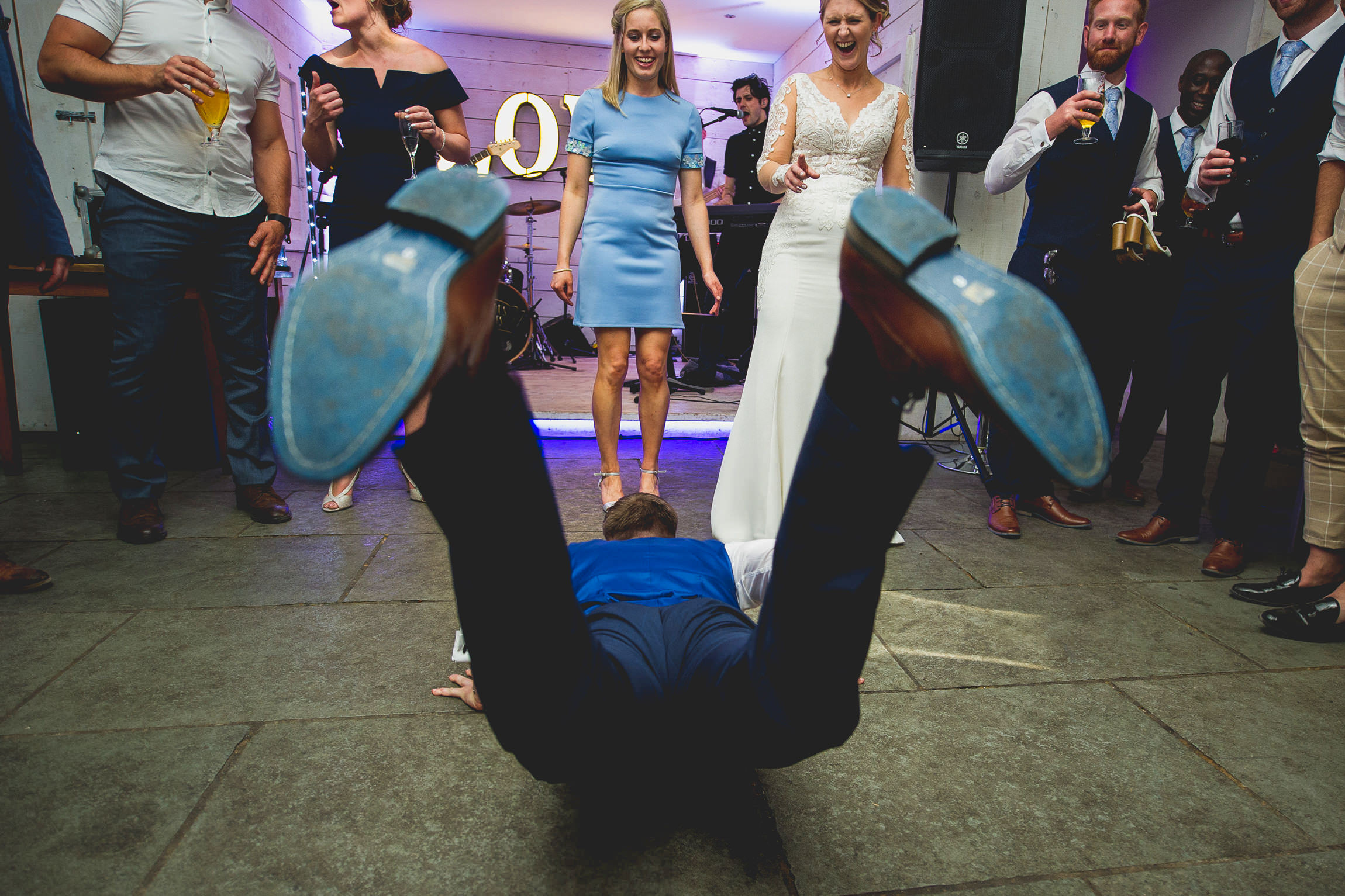 Wedding guests doing the worm on the dance floor - Documentary Wedding Photographer Manchester