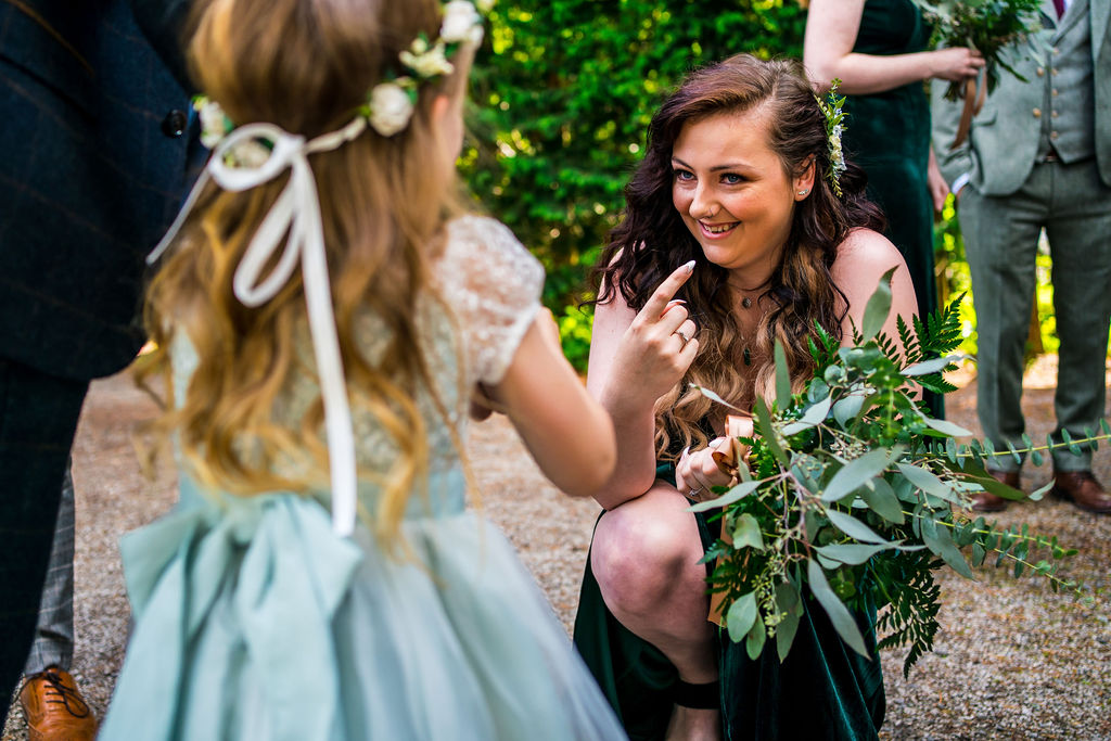 Bridesmaid enjoying a moment with a flowergirl