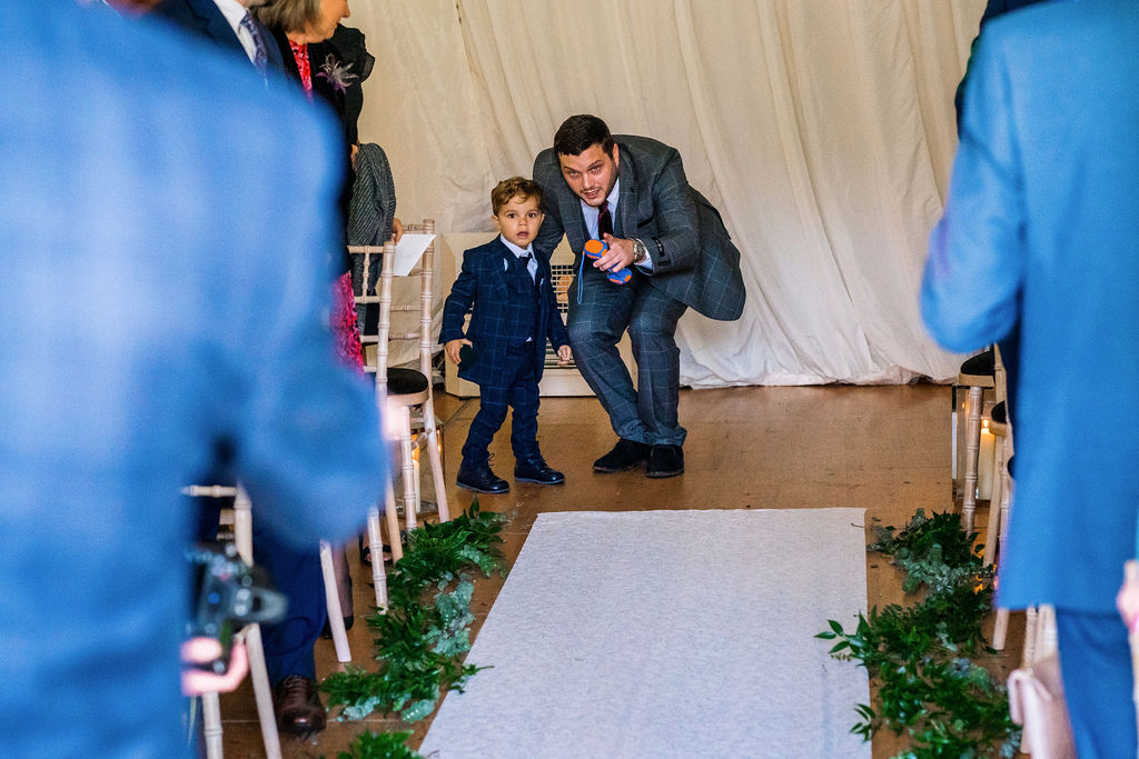 The paige boy prepares to run down the aisle