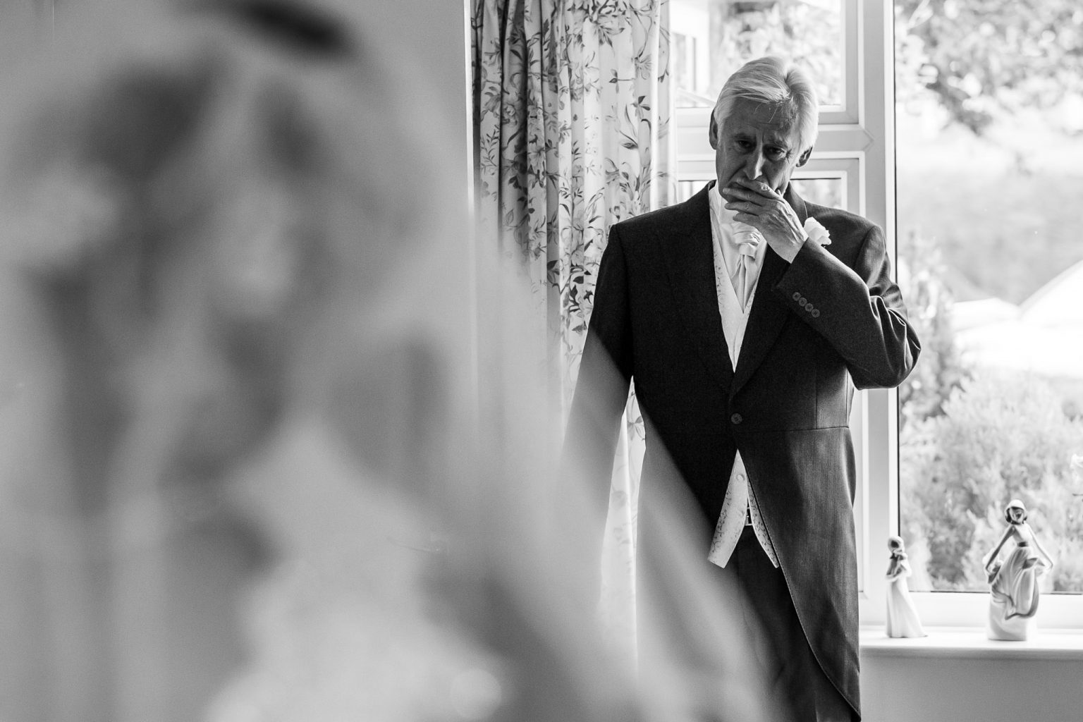 Father of the bride becomes emotional when he sees her in her wedding dress