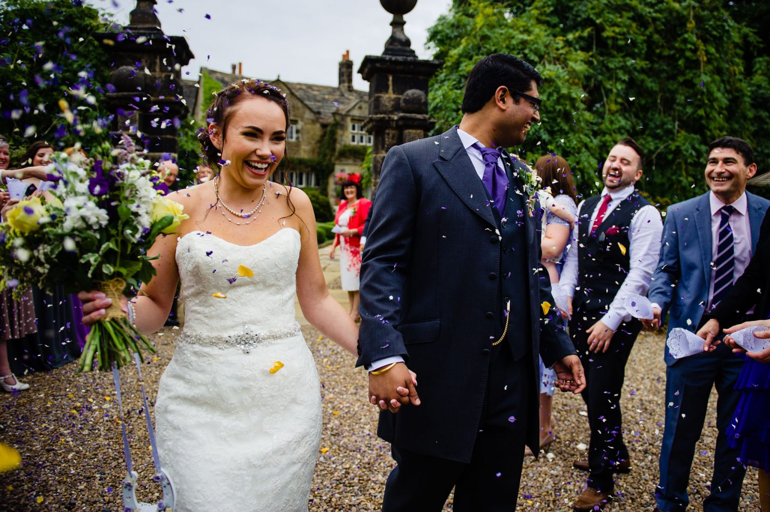 Bride and Groom enjoy a little confetti - Wedding Photographer in Manchester